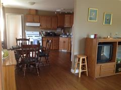 Kitchen and dining area in residential unit upstairs