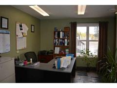 Office with slate tile flooring